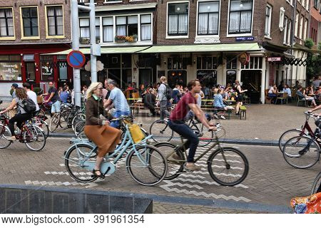 Amsterdam, Netherlands - July 8, 2017: People Visit Nieuwmarkt Square In Amsterdam, Netherlands. Ams