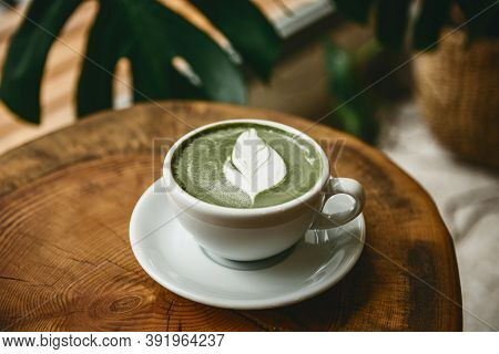 Fresh Aromatic Green Matcha Latte Tea On A Wooden Table. Natural Antioxidant And Dietary Product.