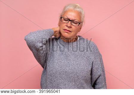 Old Woman Massage Neck, Feeling Pain Of Fibromyalgia Osteoarthritis Pinched Nerve