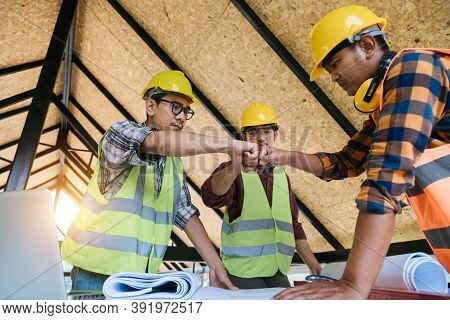 Construction Teamwork, Team Of Engineer And Architects Working Join Hands To Build Successful Projec