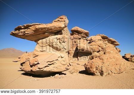 Amazing Rock Formation At Eduardo Avaroa Andean Fauna National Reserve With A Visitor Photographing,