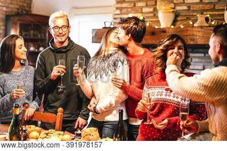Happy Friends Group Celebrating Christmas Party At Dinner Supper Fest - Winter Holiday Concept With