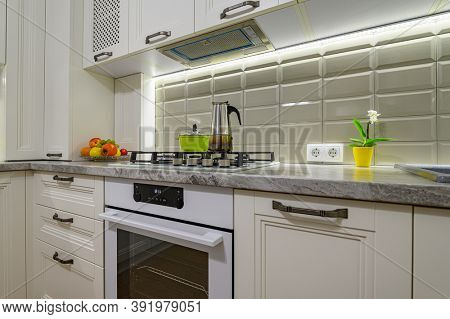 Small white cozy and comfy contemporary classic kitchen interior with wooden furniture