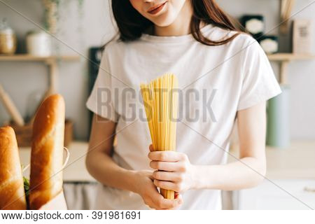 Woman Hold Wheat Spaghetti Pasta In Hands. Prepare To Cooking. High Quality Photo