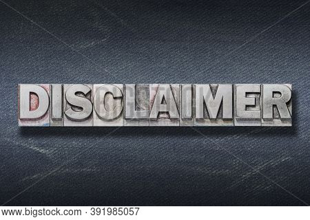 Disclaimer Word Made From Metallic Letterpress On Dark Jeans Background