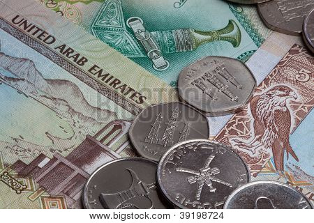 United Arab Emirates coins and banknotes  The UAE is made up of seven states  Abu Dhabi, Dubai, Sharjah, Ajman, Umm al-Quwain, Ras al-Khaimah and Fujairah poster