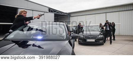 Famous Female Celebrity With Bodyguards Surrounded. Vip Security Agents And Close Protection Officer