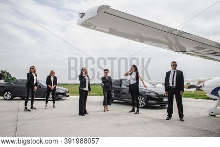 Famous Female Celebrity With Bodyguards Surrounded. Vip Security Agents