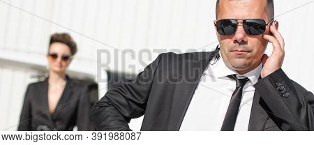 Celebbrity Bodyguard And Vip Protection Services. Black Suit And Handsfree. Special Forces. Police