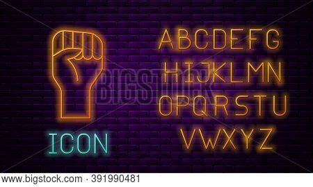 Glowing Neon Line Raised Hand With Clenched Fist Icon Isolated On Brick Wall Background. Protester R