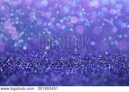 Selective Focus In The Middle For Your Product. Purple Glitter Abstract Background With Defocus Ligh
