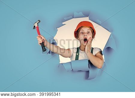Feel The Surprise. Labor Day At 1 May. Surprised Girl In Hard Hat Holds Hammer. Best Repairer Ever.