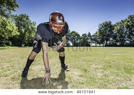 American football player offensive Lineman in in action at three point stance poster