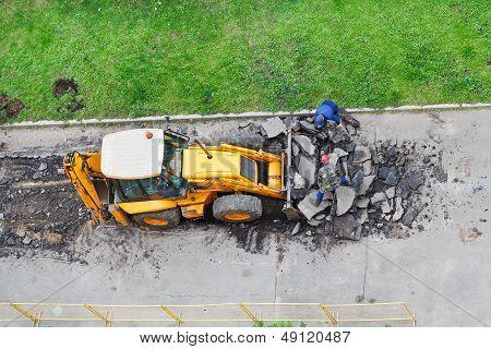 Roadmen And Tractor Remove Asphalt