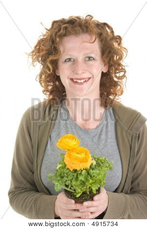 Woman Holds Yellow Potted Plant