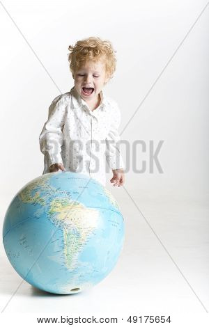 Cute toddler is holding the world in his hands