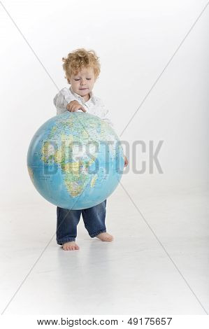 Toddler is bouncing a globe