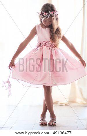 Beautiful little girl wearing fairy costume with magic wand