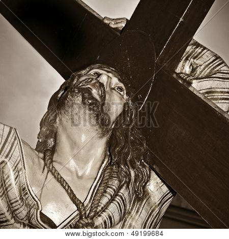 a representation of Jesus Christ carrying the holy cross