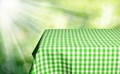 Empty checkered tabletop for product display montages poster