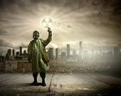 Image of man in gas mask and protective uniform touching radioactivity sign poster