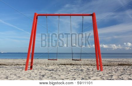Red Swing on a Beach
