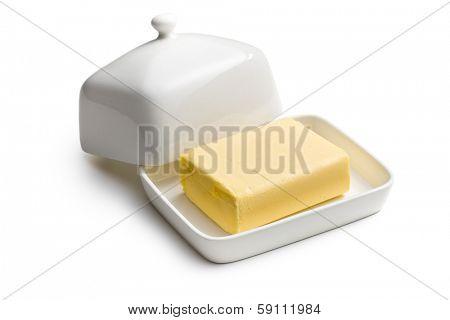cube of butter in ceramic jar