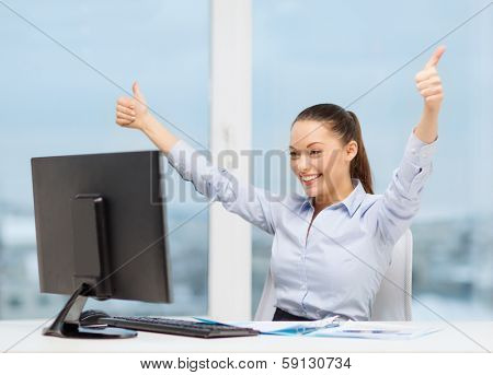 business, internet, office and technology concept - smiling businesswoman with computer and paper showing thumbs up