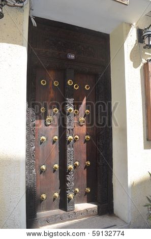STONE TOWN, ZANZIBAR - DECEMBER 12: Door of the house in which Freddy Mercury lived in Zanzibar on 12 December 2013 in Stone Town, Tanzania.