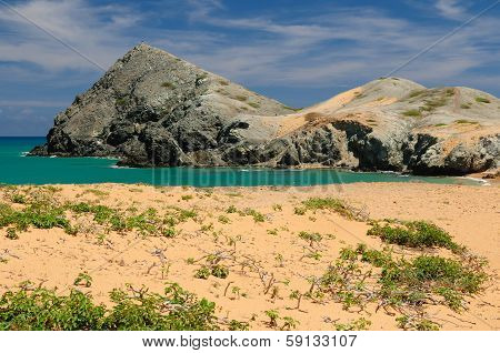 Colombia wild coastal desert of Penisula la Guajira near the Cabo de la Vela resort. The picture present beautiful Pilon de Azucar beaches of the Caribbean coast with turquoise water and orange sand poster