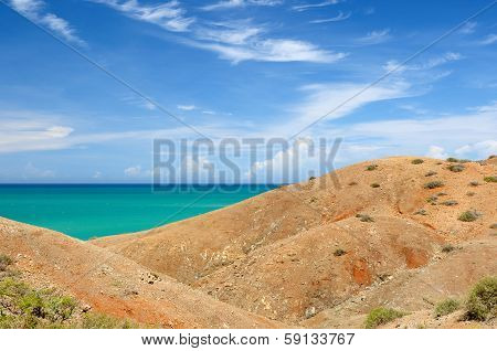 Colombia wild coastal desert of Penisula la Guajira near the Cabo de la Vela resort. The picture present beautiful Caribbean coast with turquoise water and orange sand poster
