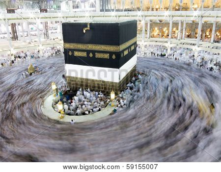Kaaba the Holy mosque in Mecca with Muslim people pilgrims of Hajj praying in crowd (newest and very rare images of Holiest mosque after latest widening 2013-2014) poster