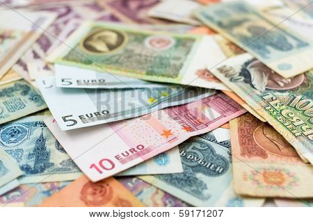 Old Russian banknotes and euro