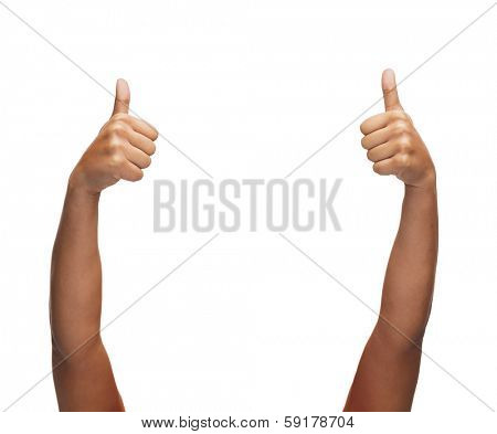 gesture and body parts concept - woman hands showing thumbs up