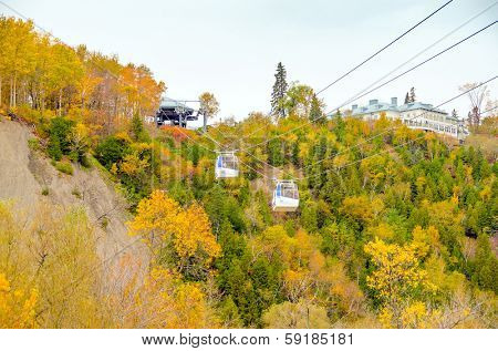 QUEBEC CITY, CANADA, OCTOBER 13, 2013 -  Cable cars in Montmorency Falls Park. The waterfall is 83 m tall, a full 30 m higher than Niagara Falls.