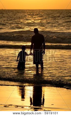 Father And Son At The Ocean