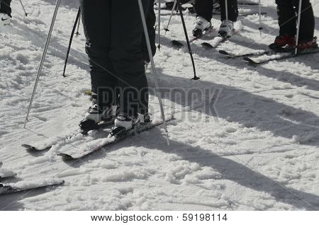 Skier wait turn for slide in whiter