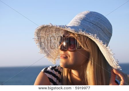 Young Smiling Blond Woman Looking At Sunset