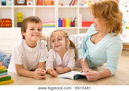 Kids Having Fun Reading Stories With Their Mom