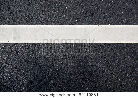 White Paint Line On Asphalt Road