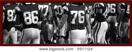A black and white photo of an American football team with a burgundy frame around it. poster