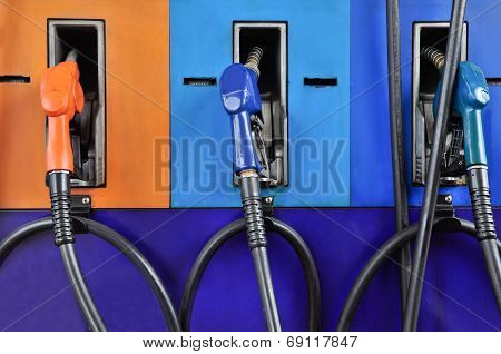 Several Gasoline Pump Nozzles At Petrol Station, Gasoline Industry poster