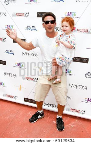 BRIDGEHAMPTON, NY-JUL 19: Mark Feuerstein (L) & his niece Lily Rae Feuerstein attend the 6th Annual Family Fair at Children's Museum of the East End (CMEE) on July 19, 2014 in Bridgehampton, New York.