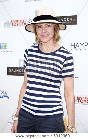 BRIDGEHAMPTON, NY-JUL 19: Actress Christa Miller attends the 6th Annual Family Fair at the Children's Museum of the East End (CMEE) on July 19, 2014 in Bridgehampton, New York.