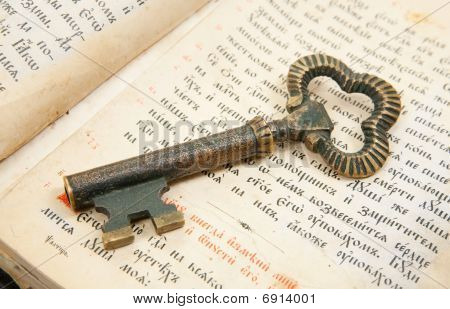 Closeup Of Key Placed On Vintage Bible