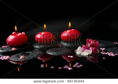 Spa Concept Of White And Red Orchid (cambria), Three  Red Candles And Pearl Beads On Zen Stones With