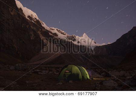 Iluminated Camping Tent On The Base Of Alpamayo Mountain