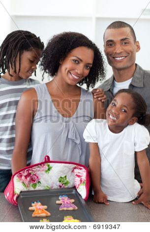 Loving Family Showing Handmade Cookies