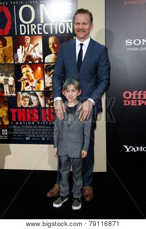 NEW YORK-AUG 26: Director Morgan Spurlock (top) and son Laken attend the New York premiere of 'One Direction: This Is Us' at the Ziegfeld Theater on August 26, 2013 in New York City.