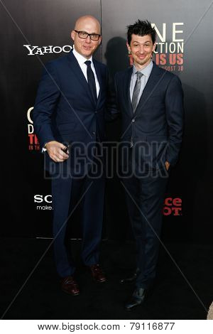 NEW YORK-AUG 26: Executive Producer Jeremy Chilnick (R) and guest attend the New York premiere of 'One Direction: This Is Us' at the Ziegfeld Theater on August 26, 2013 in New York City.